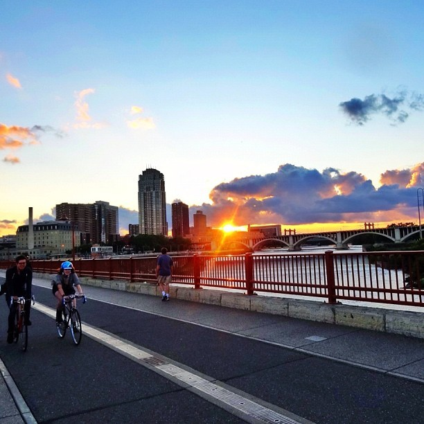 #sun #clouds #bikes #stonearch #bridge #mpls #minnesota #minneapolis #twincities #picoftheday #photooftheday #sunset  (Taken with Instagram at Stone Arch Bridge)