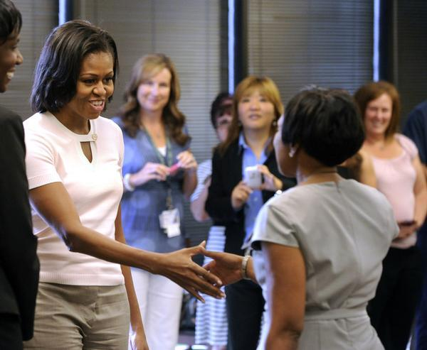 "Michelle Obama visits Aurora hospital to thank doctors, nurses for actions First lady Michelle Obama reached out with both hands, gave hugs and offered thanks to doctors and staff Saturday during a surprise visit to the Medical Center of Aurora. During a visit that lasted a little more than an hour, the first lady thanked doctors, nurses and other staff members who cared for the wave of patients who were rushed to the hospital on July 20, after a lone gunman fired into a packed theater at the Century Aurora 16 multiplex during a midnight premiere of the new Batman movie, ""The Dark Night Rises."" Twelve people were killed and another 58 were injured in one of the worst mass shootings in American history."