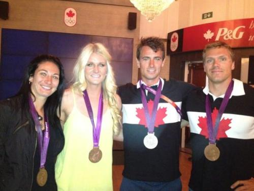 they do wear their medals everywhere eh? marie-eve nault, kaylyn kyle, adam van koeverden, and mark de jonge.