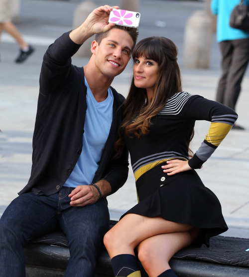 christopherpeterson:  Lea Michele and Dean Geyer snap a cellphone pic in Washington Square Park filming Glee in New York City