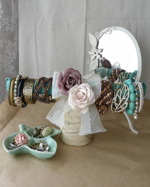 DIY bracelet holder! just take a paper towel cardboard tube, wrap fabric, bows, and flowers around, and glue a cup to the bottom! So easy!