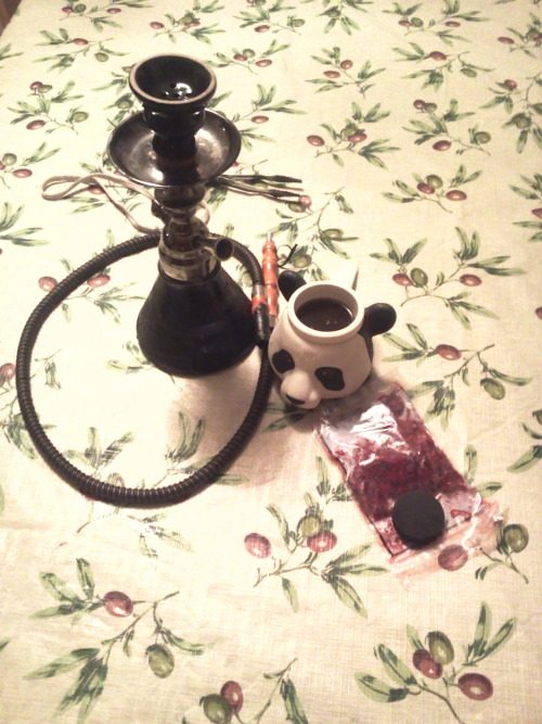 My Hookah with my panda bear cup that I got at the indy museum  when i was 6 There is coffee in it