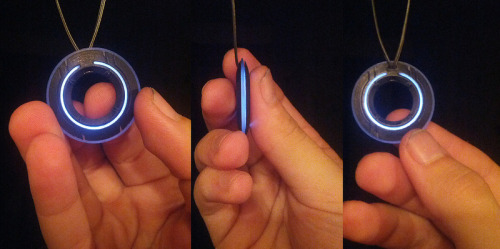 Tron disk necklace by Chris Myles:  3 Part 3D printed necklace inspired by Tron Legacy. Small Strip of EL wire inside is powered via the necklace cord with power and EL intverter in the clasp.