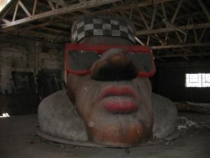 "HUMPTY HEAD NEEDS HOME Here's an update on the Humpty Head. I have learned from a former tenant of the building that a man was evicted from his apartment, and then lived surreptitiously in the head for several weeks before being discovered.  There's a small green room in there, you see, for Humpty to wait in before he arises. I emailed the L.A. Museum of Hip-hop History, they are uninterested. Help me Tumblr you're my only hope!  Reblog this post and bring the Head into the hands of those that love and appreciate it!  GIANT HEAD OF HUMPTY HUMP NEEDS A HOME There is a warehouse in Oakland that rents cop cars and such to the entertainment industry.  Therewithin lies the giant head of Humpty Hump, which was used in the video ""Return of the Crazy One"" in 1993, and then the client ditched out on their storage bill and there it sits to this day.It could be had for the price of transport.You go in the back of the head and the nose splits open and you rise out in glory.   I will deliver. http://www.youtube.com/watch?v=zv7zapLMVU0&feature=player_embedded"