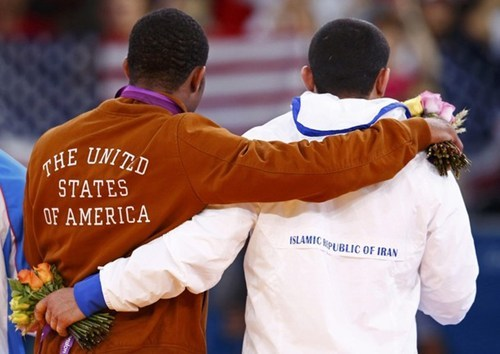 thedailywhat:  Medal Stand Photo of the Day: American Jordan Burroughs' gold medal victory over Iran's Sadegh Goudarzi in men's 74kg freestyle wrestling led to this poignant photo, proving the Olympic brings the world together like no other event. [kateopolis]