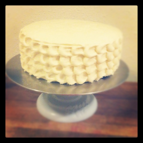 Wedding Cake Test, take 1! So I've decided… no. It was never a choice. I'm going to make my wedding cake.  I'm super excited about it. To the point where I had about 20 tabs open at any given point researching the how-to's of stacking cake tiers, what the best recipes are for sturdy cakes, whether I should even attempt a homemade fondant when I'm not a fan of the icky sugar clay in the first place…. So lo and behold. Cake #1. I was testing for flavor as well as the sturdiness of cake and also the crusting of the buttercream recipe. It's alot to test all at once. Not very much following the scientific method, if you ask me… And because of this, I ran into a number of problems. First being, when you don't have controls in place, you can't find the error!  So it was tasty, but it just wasn't quite right… The first loser of this Wedding Cake Battle Royale?   Lemon Poppyseed cake with White Chocolate Cream Cheese Buttercream icing and a Blackberry curd filling.  Say that 3 times fast! The cake should have used a moistening syrup which I forgot.  The icing was really strong and sweet, but had no idea until after cake test #2. I was REALLY pushing for that sucker!  And the blackberry curd filling? I still have a little hidden away in the fridge for a lonely night. Mmm… Recipes deviated an egregious amount, but can be partially credited to Cake Central, MyRecipes, and Martha Stewart .