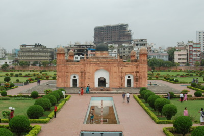 Lalbagh Fort, Dhaka, Bangladesh. Check out that contrast with new Dhaka rising up behind it. Only in developing countries have I seen the majority of billboard advertising be devoted to building supplies—concrete, steel bars, etc. Photo by Smellvester Cologne.