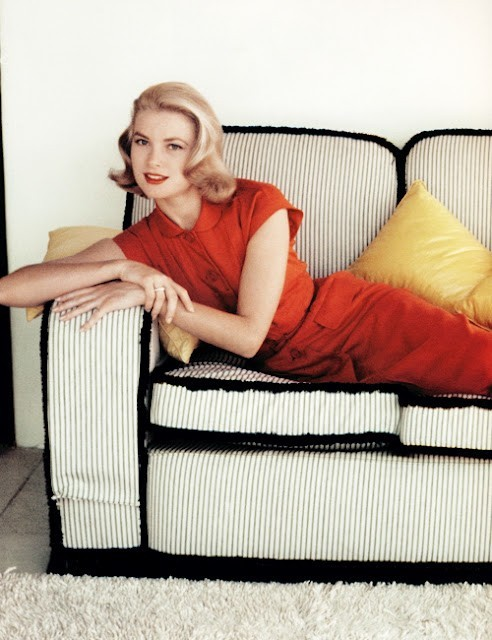 Not only does Grace Kelly always look fab, but even this couch is awesome.  theniftyfifties:  Grace Kelly