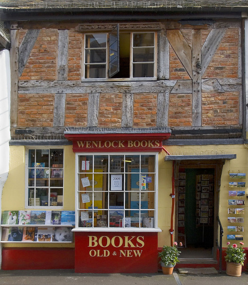 "thebookenchantress:     Wenlock Books in the quintessentially English village of Much Wenlock, Shropshire. Savidge Reads reviews it thusly: ""(At Wenlock Books) you… are hit with a level of book porn almost too tempting...and then you go upstairs, where nooks and crannies of bookish delights await you in secret corners."" Okay, I am convinced. Someone take me please. (image wikimedia)"