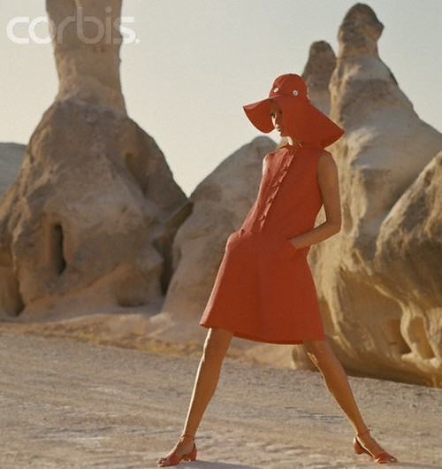 Model wearing a sleeveless red linen dress by Kasper for Joan Leslie, Goreme, Turkey, 1966. Photo by Henry Clarke.