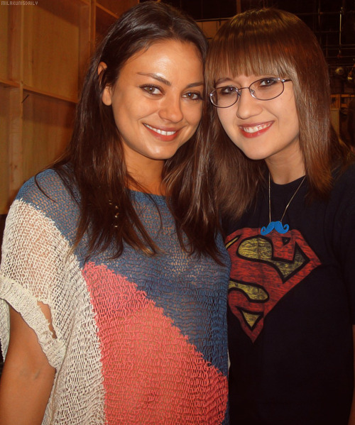 "milakunisdaily:  Mila Kunis visited boyfriend Ashton Kutcher on the set of his hit TV show, Two and a Half Men, on Friday (August 10) in Los Angeles. She took photos with fans and here she is with ""stalker sarah""."