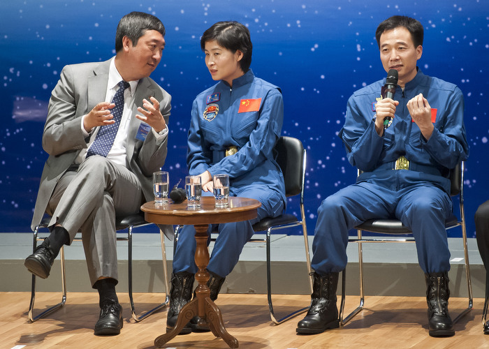 HONG KONG: Aug. 12, 2012 — Astronaut Liu Wang (right) speaks to students at a seminar sharing their space experience with university students while Liu Yang (center), the nation's first woman in space, interacts with Prof. Joseph J.Y. Sung (left), Vice-Chancellor and president of The Chinese University of Hong Kong, in Hong Kong Sunday, Aug. 12, 2012. (Photo by JUSTIN CHIN)
