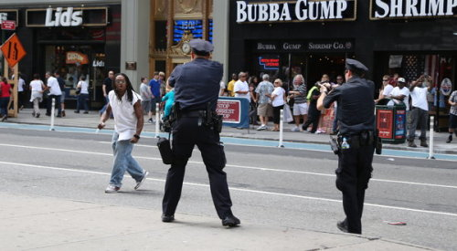 "Knife-wielding man shot, killed by police in Times Square: The shooting, which took place at 3 p.m. Saturday, happened after the man reportedly threatened tourists and bystanders, was sprayed with pepper spray, and attempted to rush police. ""He continued to advance on uniformed officers, refusing officers' repeated commands to drop his weapon,"" said police spokesperson Paul J. Brown. The shooting happened at a particularly rough hour for something like this — at a point in the week when Times Square is loaded with tourists. (photo by Lincoln Rocha for The New York Times) EDIT: Via MegsOkay, here's video of the shooting."