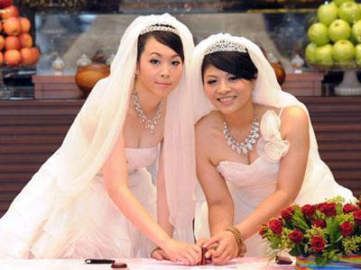 "gaywrites:  Fish Huang and You Ya-ting became the first same-sex couple to marry in a Buddhist ceremony in Taiwan this weekend, hoping it will prompt government officials to recognize marriage equality. Their wedding is historic and symbolic, though unfortunately not legally binding.  ""We are witnessing history. The two women are willing to stand out and fight for their fate… to overcome social discrimination,"" Buddhist minister Shih Chao-hui said, according to AFP, with nearly 300 Buddhist attendees chanting sutras to bless the couple. The brides' parents did not attend because of concerns about the media attention. Story here."