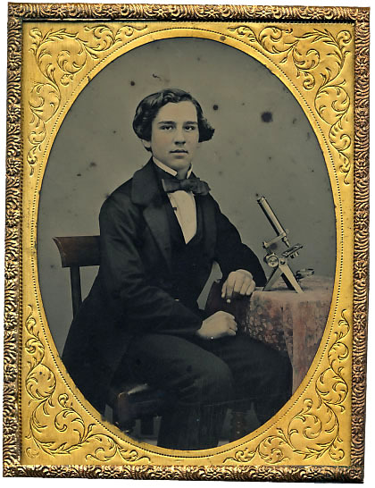 ca. 1860's, [ambrotype portrait of a young English student with his microscope] via Stereographica, Antique Photographica