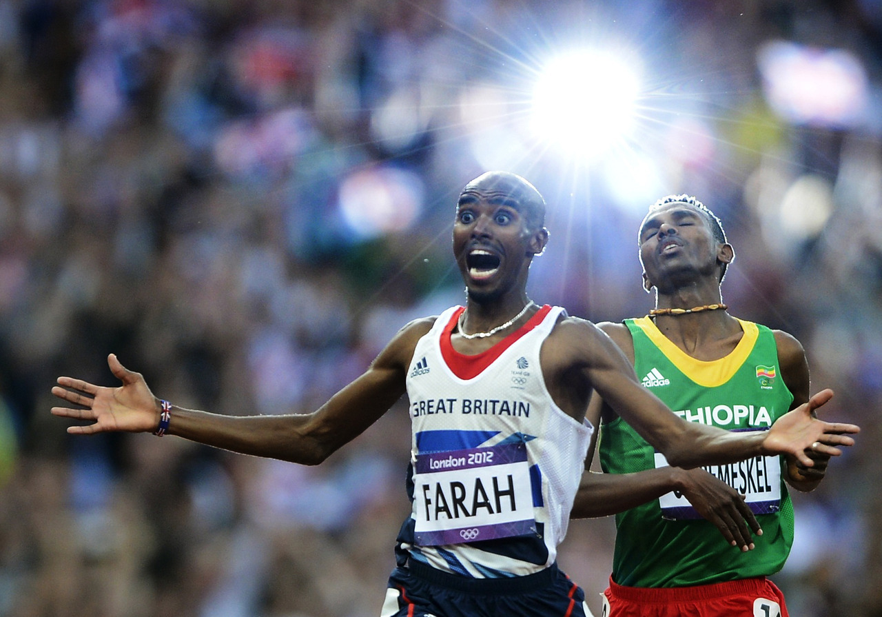 Britain's Mo Farah (L) reacts as he wins the men's 5000m final ahead of Ethiopia's Dejen Gebremeskel at the London 2012 Olympic Games at the Olympic Stadium August 11, 2012. [REUTERS/Dylan Martinez] FULL COVERAGE: The London 2012 Summer Olympic Games
