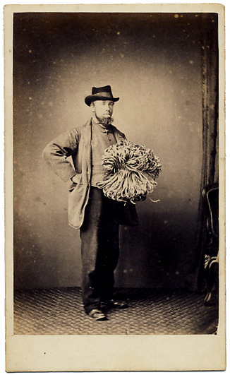 ca. 1870's, [carte de visite portrait of a gentleman with an armful of what appears to be string or cord], Geo. Avery via Stereographica, Antique Photographica