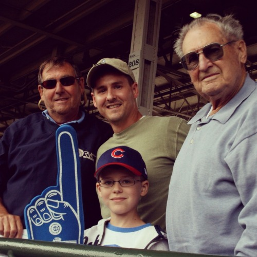 Four generations of Cubs fans take in a game at Wrigley Field.