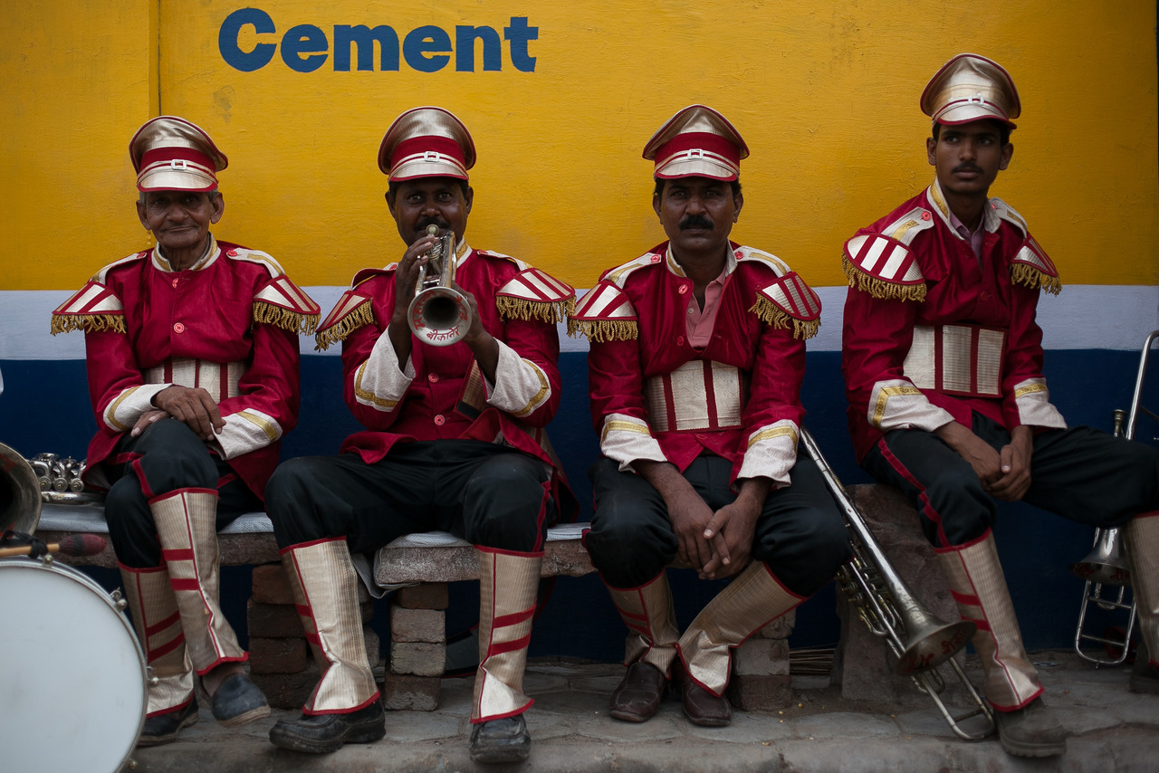 The Players - A wedding band in Rajasthan, India waits for a rickshaw ride with their instruments.