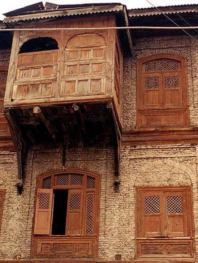 "postcardfromkashmir:  ""Varusi"" or ""Dub"" These type of houses are still seen in ""shehri-khas"". A wooden varusi (movable/sliding partition) comprising of a foliated arch, with removable wooden panels (dilli puth), 20th century. The wooden Pinjra shutters and Maharaji brick of this modest house define the vernacular architecture of Kashmir."