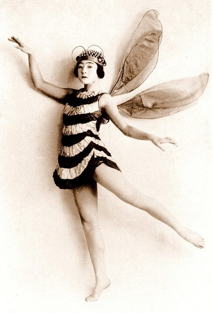 Pattern!  Color!  More stripes…1920's bee costume. Via evelynnowadays.