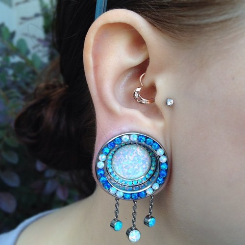 gegele40:  richardeffinivey:  Lindsey's new ANATOMETAL super duper orbit plugs with dangles. (Taken with Instagram)  Her ear is gorgeous  I stared at this photo for about five minutes before reblogging it.  So pretty!