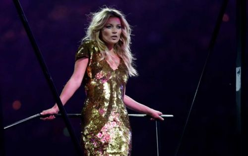 London-born model Kate Moss wearing a gold Alexander McQueen dress at London 2012 Closing Ceremony