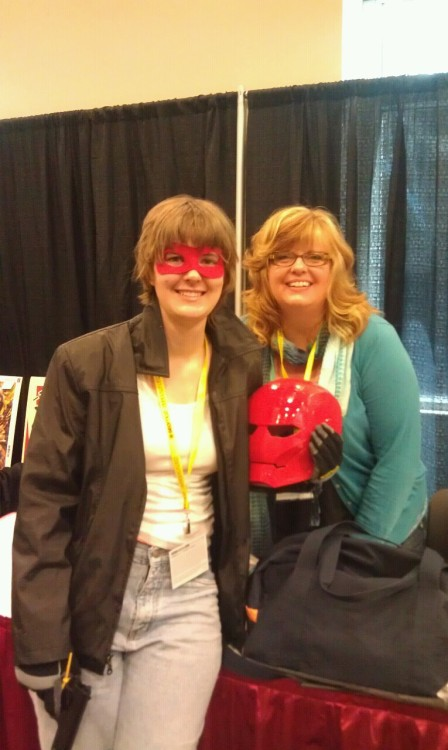 Me as Red Hood, and Gail! Meeting Gail and the hubby was awesome- they were both so nice. I didn't expect to be so easily recognized, either. @_@  Geek Girl con was amazing. I have more pics, but they'll have to wait a while to post.  I am overall pleased with my costume, but I do wish I had had time to dye my hair. It's naturally far too light a color for Jason, and it almost looks red here, which, no, Jason's hair is black and fuck you B &R. Still, everything else turned out great. TY again to Rasha for the spirit gum and offer of a wig, even though the wig didn't work out. Overall, great fun, hope they have one on my coast soon so I can go more reliably.