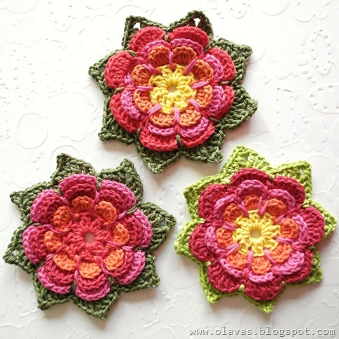 Check out this lovely crocheted flower from Olavas Verden! There is a detailed tutorial to be found through the link (although in Norwegian).  Seems pretty clear to follow though, and lovely detailed pics.  Enjoy!