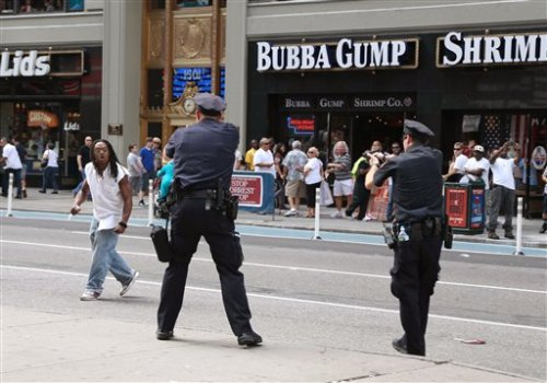 "BREAKING: NYPD shoots a man dead in the middle of Times SquareAugust 12, 2012 New York City police shot and killed a knife-wielding suspect as he sought to evade them through Saturday afternoon traffic and pedestrians in New York's Times Square, authorities said. Police said on Sunday they approached Darrius Kennedy, 51, while he was smoking what appeared to be a marijuana cigarette. He became agitated, broke free from an officer's grip and pulled from his pocket a knife with a six-inch (15-cm) blade, said police spokesman Paul Browne. Kennedy headed south, weaving through dense pedestrian and vehicle traffic, as more police officers arrived at the scene. ""He was repeatedly told throughout this period to drop the knife and we have scores of witnesses who heard the officers doing that repeatedly,"" Browne told a press briefing. Kennedy was pepper-sprayed six times but did not respond. After he was again told to drop the knife, two officers fired on him, Browne said. Twelve shots were fired, and Kennedy was hit seven times — three times in the chest, twice in the left arm, once in the left calf and once in the groin. The two officers, who were not immediately identified, have been placed on administrative duty. ""Right when he pulled the knife, the cops drew their guns,"" Lincoln Rocha, 28, who was visiting from Brazil, told the New York Times newspaper. ""Some people were crouching near an office building… But others took out the cellphone cameras to try and capture it."" As police officers pursued Kennedy, dozens of onlookers, including Rocha, trailed behind, he told the newspaper. Kennedy was later pronounced dead at Bellevue Hospital Center, Browne said. The incident may stir additional controversy about the city's so-called stop-and-frisk policies, which have been criticized as targeting racial minorities. Kennedy was black. Source NYPD continually proves itself to be the most dangerous gang."