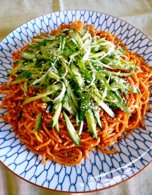 Dandanmian Topped with fresh cucumber, shredded scallions and toasted sesame seeds.