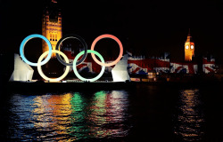 olympicsusa:  Illuminated Olympic rings are displayed near the Houses of Parliament as part of the festivities for the closing ceremony of the 2012 London Olympic Games in London Photo by Toshifumi Kitamura