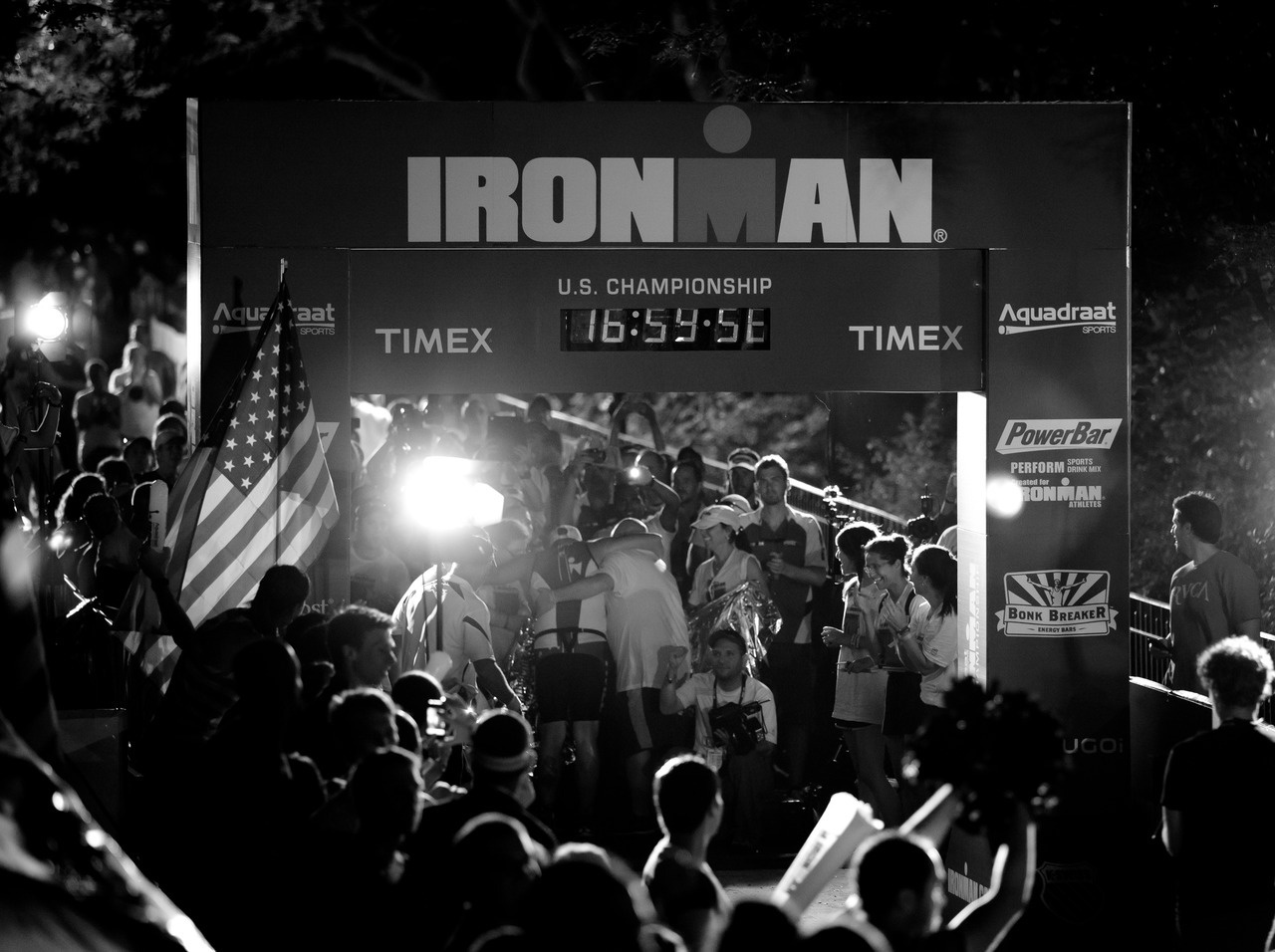 Made of Iron A male age-group triathlete crosses the finish line in Riverside Park right before the 17-hour cutoff during the Ironman U.S. Championship.  Observe More on Flickr