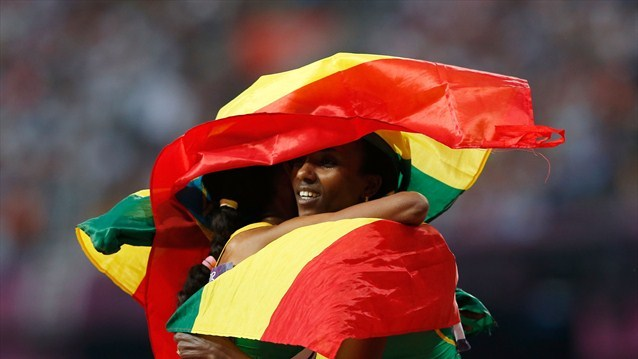 This photo of Meseret Defar and Tirunesh Dibaba of Ethiopia celebrating while wrapped in their country's flag is one of my favorite photos from the London 2012 Olympics.  The joy on their faces as they embrace each other and, symbolically, their country is really what the games are about. Photo by Jamie Squire
