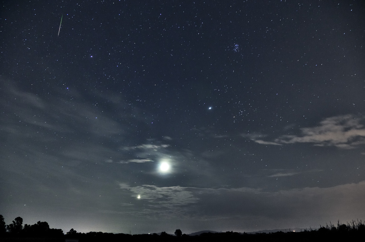 cometsmeteoroids:  By Nico Palermo A Perseid meteor, Jupiter, the Moon and Venus rising, the Pleiades and some cloud that liked the show really much.