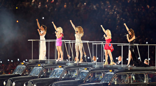 inothernews:  Remember. (Photo of the Spice Girls reunited during the closing ceremonies of the 2012 London Olympics by Chang W. Lee / The New York Times)