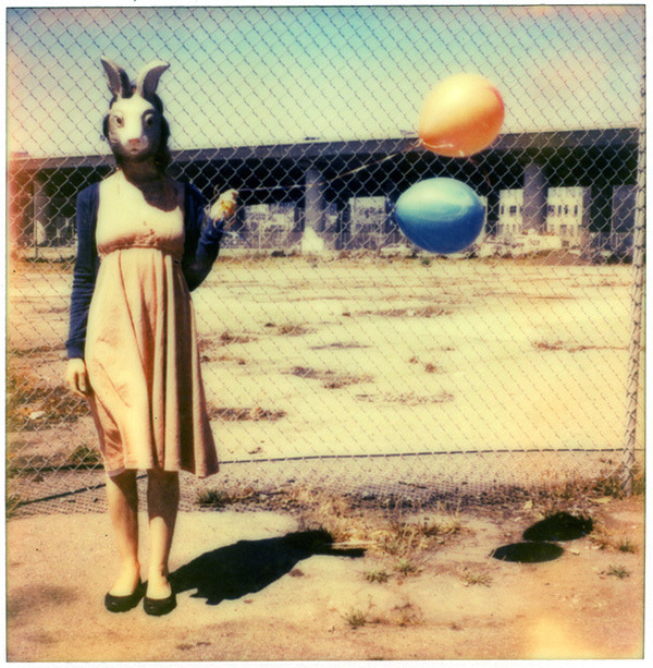 'RoidWeek #2: rabbit (finch & balloons) on Flickr.Impossible Project PX 680 Color Shade, Polaroid 680. A big thanks to Finch, who responded to a tweet* and was comfortable getting in a car with people she'd just met to drive her to a derelict part of town to photograph her in a rabbit mask. :) * twitter.com/hchamp/status/233929410447806464
