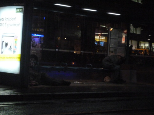 This is a picture of two homeless people sleeping in a tram stop at 1.30am. It was taken in Munich - one of the richest cities, in one of the richest regions, in one of the richest countries, in one of the richest regions of the world.