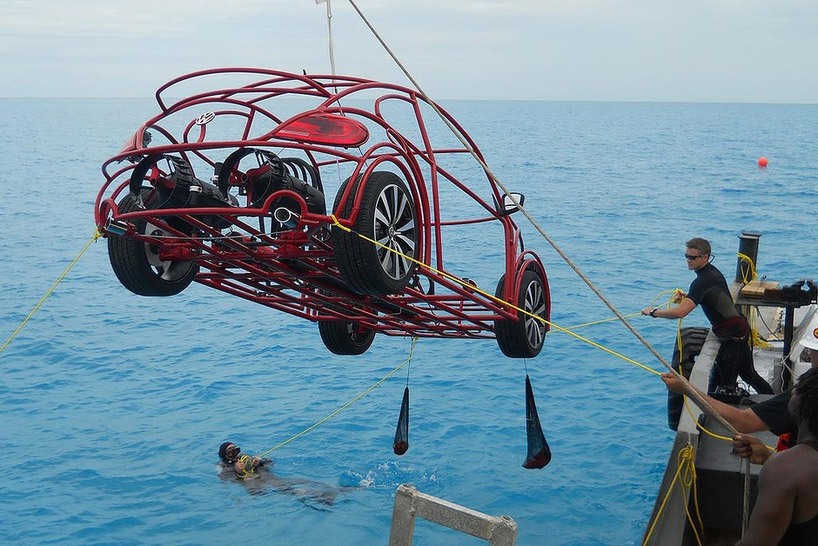 samaralex:  Volkswagen Beetle Mobile Shark Cage Not only is it a functional (and fashionable!) shark cage, it's also drivable on the ocean floor due to a full air system and two propellers.