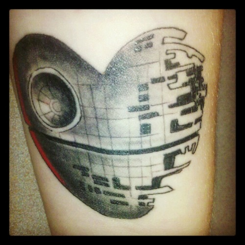 This is my Death Star tattoo. I love the symbolism that it is still in it's building stage and has yet to be destroyed. Just like me!  It was done by Tom Morris at All American Tattoo