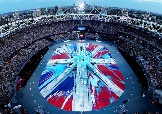 Hirst's Olympic Ceremony Damien Hirst took center stage in last night's Olympics closing ceremony; his enormous, patriotic spin painting of the Union Jack covered the floor of London's Olympic Stadium! The flag's three crossed white lines formed the ramps on which the evening's fleet of London cabs drove.