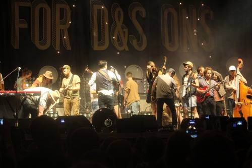 savidraws:  Mumford and Sons in Bristol  I think it's so awesome looking through the M&S tags on Tumblr to look for Bristol related things. I've lived [near] here all my life. Drive through 3 times a week, and never really seen anything special about it. Then they said Mumford and Sons was coming, and I took the opportunity to go see one of my favorite bands. But, walking State Street for the millionth time before their set, and seeing how happy everyone was brought me the best feeling ever. I finally seen what everyone else had seen about Bristol. Even M&S. It was the best feeling in my life. When I finally got back to the parking lot to watch them perform, seeing all those people, again, brought me the best feeling. But then, They came out. As soon as the first guitar chord was played, and with all the crowd cheering, that, that feeling of everyone being together, and being happy, those things, with Mumford and Sons' beautiful music, while I experienced that, I realized, that was the happiest moment of my life. I had never had such a flow of emotions. I had to stop myself from tearing up. One band, brought me to the happiest moment ever. By bringing together a community of fans. I know, if you read ALL that, you're saying 'this kid had the best feeling of his life a lot that day.' But, it was better every time. I have been pretty bummed lately, and during that evening, I was totally free.  I also bought my ticket off one of my uncle's friends for $80 at 11:30 the morning of the show. So, I should thank him.  I apologize to whomever's photo this is for expressing myself on your post. Why didn't I just upload my own to say all this? My phone died 1:20 into Little Lion Man. And, I didn't care for once.