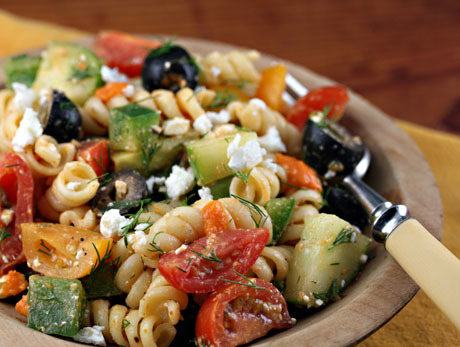 thatsmegmade:  Greek Pasta Salad with Sun Dried Tomato Vinaigrette  IngredientsFor the dressing1 garlic clove7 sun-dried or slow-roasted tomato halves, roughly chopped2 Tbsp plain nonfat yogurt1 tsp Greek seasoning1/4 cup white wine vinegar1/4 cup extra virgin olive oil1-1/2 tsp agave nectar (or honey, or sugar substitute)5-6 tsp water For the salad8 oz rotini or other twisty pasta1-1/2 cup diced fresh tomatoes1 cup diced cucumber1/2 medium green bell pepper, diced1/2 cup pitted large black olives, sliced in half3 Tbsp chopped fresh dill1/2 cup crumbled feta cheese, or more to taste Directions In a blender, combine all dressing ingredients, and blend on high speed until smooth. If you'd like the dressing thinner, add a bit more water. Set aside. Bring 4 quarts of water to the boil in a large pot. Cook the pasta according to package directions; drain and add to a large mixing bowl. Combine all remaining ingredients in the mixing bowl along with as much of the dressing as you like. Garnish with some extra dill fronds, and serve at room temperature. Source: The Perfect Pantry