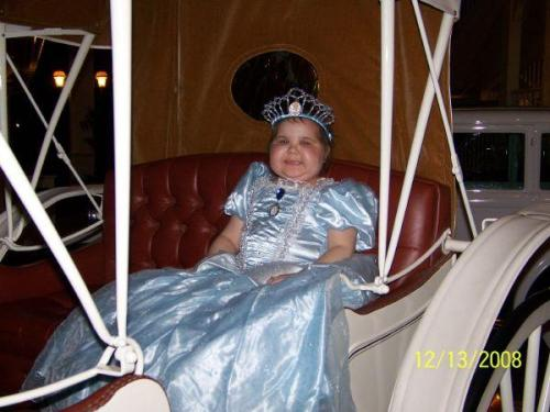 Princess Elise in her carriage on her wish trip to Disney World! What a lovely picture!