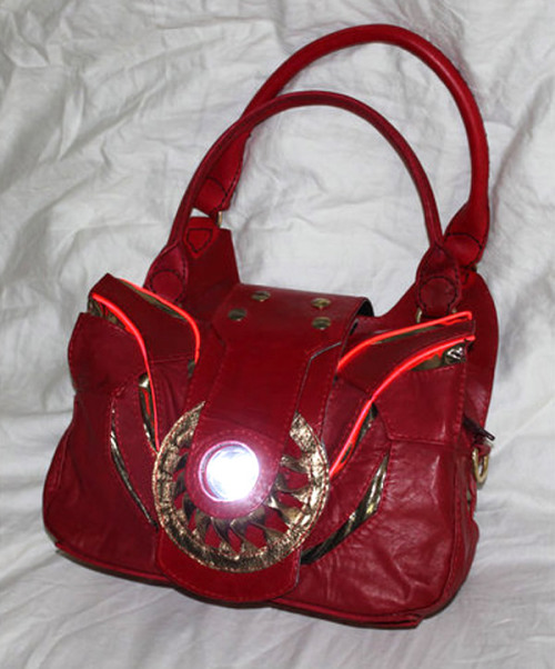 Iron Man Bag For some reason, I could actually see this as a product from Stark Enterprises, right after Tony unveils himself as Iron Man to the public. While we don't actually have Stark Enterprises, we do have the creative mind of TheGoddess908 who created the purse. In addition to being able to carry all the essentials, the item has a Arc Reactor that lights up thanks to EL Wire technology. It was also entirely hand-sewn. [Technabob]