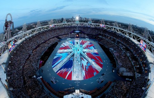 DAMIEN HIRST'S FLAG AT LONDON OLYMPICS CLOSING CEREMONY London celebrated the closing of the Summer Olympic ceremonies with many a star-studded bang Sunday night, incorporating many of UK's most famous celebrities including a much-talked-about reunion by the Spice Girls. Local art icon Damien Hirst also got in on the action with his recreation of the Union Jack in his signature spin-painting motif. Unveiled as part of the event, the piece was Hirsts largets ever, and became a talking point of the entire celebration.