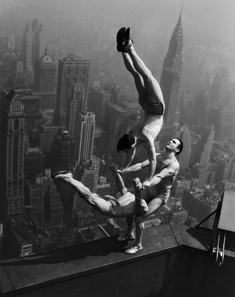 Acrobats climbed to the 86th floor of the Empire State Building in New York City to do some tricks.