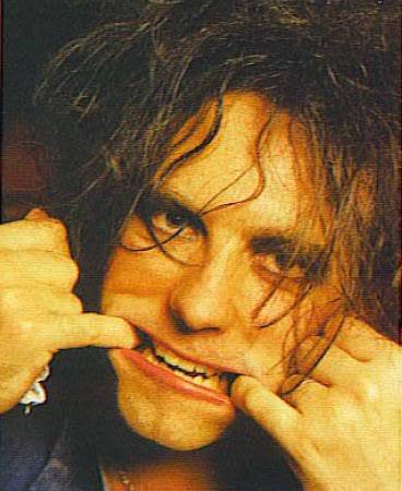 [Robert Smith, pulling a face]  No stop it you absolutely precious little old man