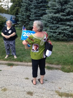 Debby Prescott of Ames, Iowa, wears the Obama shirt she had made in Ghana (Olivier Knox)