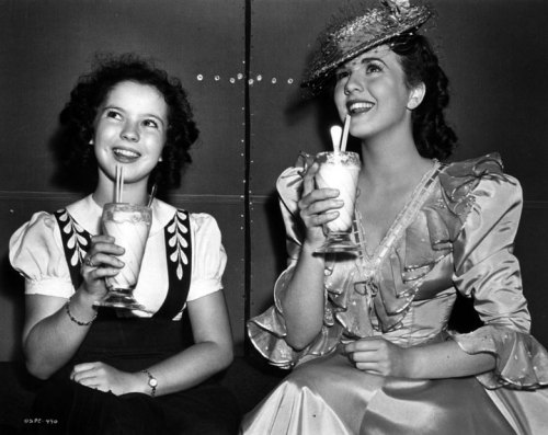 Shirley Temple and Deanna Durbin enjoying milkshakes.